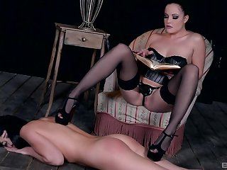 Lesbian femdom session with raven haired babes and a strap on