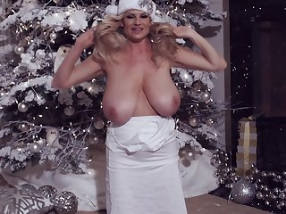 Charming big tits Kelly stripteasing infront of x mas tree