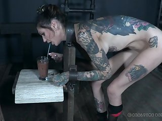 Inked babe Rocky Emerson gets her face messed up in a torture session