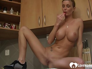Blond mommy strips and pleasures herself passionately