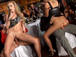 Aroused blonde fucked in the ass during public orgy