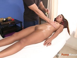 Adorable Thai girl massaged and fucked on the table