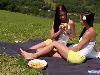 Christy Charming and Kari K go down on each other on a picnic