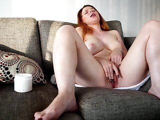 Video of a mature redhead playing with her orgasmic pussy - Madison