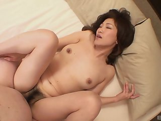 Hairy pussy Japanese mature Setsuko Miwa spreads her legs for sex