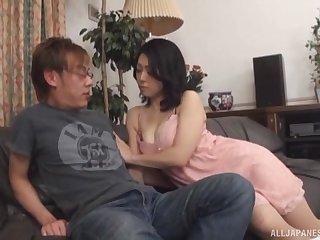 Horny Japanese mature Miwako Yamamoto gives a handjob to her hubby