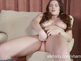 Lena Lake fingers her hairy pussy